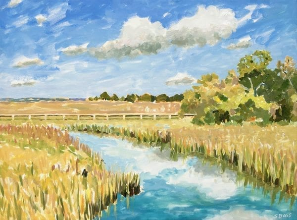 An open landscape reflects the bright morning sky and clouds at Shem Creek Park.