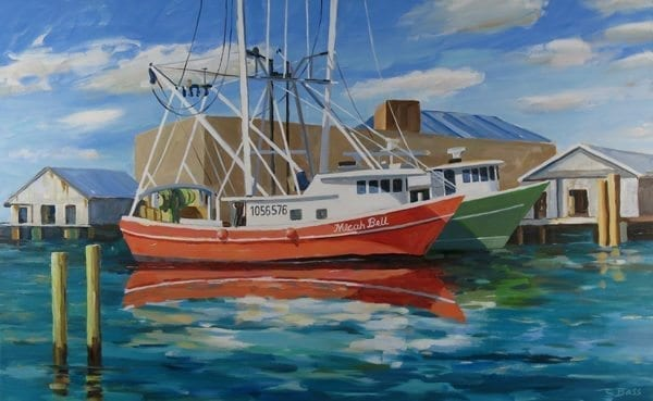 Bright shrimp boats prepare for a day of fishing.